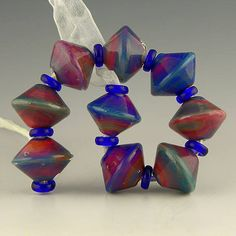handmade lampwork glass bead set of 9 short bicones in purple red pink and blue silverglass - Umami