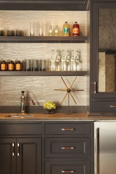 built in bar, gray cabinets, open shelving, leather hardware pulls, wallpaper