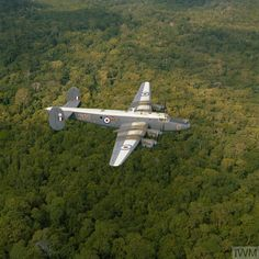 05495ece35c An Avro Shackleton aircraft of No 205 Squadron RAF over the jungles of  Labuan