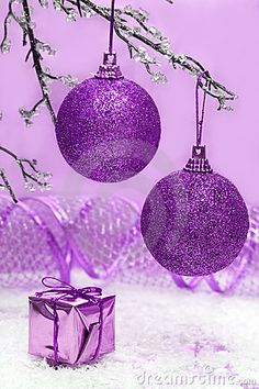 Violet Christmas balls by Viktoriia Kulish, via Dreamstime