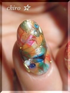 I'm dying over how gorgeous this nail art is!!!  An almost stained-glass Indian sari, gold blinged look!  Now if only there was a tutorial for it, but use this as your inspiration and rock it your own way!