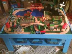 DIY Train Table.... My Hubby is making this for our kids... MUCH cheaper than buying one!