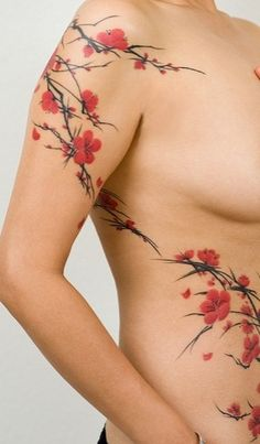 Cherry blossom tattoo this is different than the wispy ones. But I love the pop…