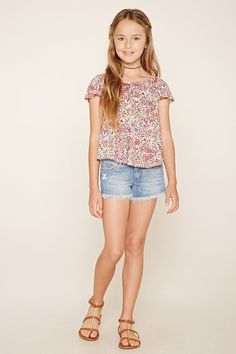 Forever 21 Girls - A slub knit floral print top with cap sleeves, an elasticized round neckline, and a tulip back.