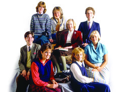 """Ann Barr, centre co-author of The Official Sloane Ranger Handbook, with the staff of Harpers and Queen in 1983: """"we concentrated on the Sloane mindset, rituals and language."""""""