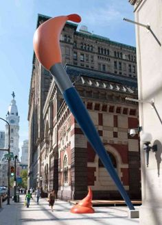 """Paint Torch - Philadelphia, PA.  Claes Oldenburg's 50-foot-tall """"Paint Torch""""  towers over pedestrians at the Pennsylvania Academy of the Fine Arts."""