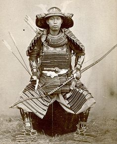 Samurai holding a yumi (bow) by Ueno Hikoma a pioneer Japanese photographer, born in Nagasaki. He is noted for his fine portraits, often of important Japanese and foreign figures, and for his excellent landscapes, particularly of Nagasaki and its surroundings.