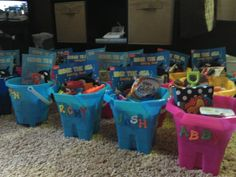 Personalized party buckets for my son's first birthday party...bubble guppies themed