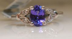 This gorgeous Tanzanite is set in a 14 karat mounting with some designwork and melee diamonds on the side, $869  (call us for more info toll free at 1-877-422-7979)