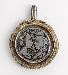 Pendant with facing couple, 15th century, Italy. Silver gilt and niello. The Metropolitan Museum of Art.