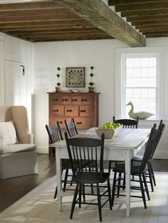 Nancy Fishelson  Simple and elegant.  Love the black chairs with the white table.