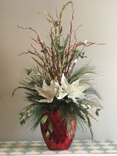 This is centerpiece pretty enough to brighten any corner of your home Christmas Flower Arrangements, Christmas Flowers, Winter Flowers, Floral Arrangements, Christmas Tablescapes, Outdoor Christmas Decorations, Flower Decorations, Christmas Centerpieces, Woodland Christmas