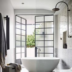 This bathroom is everything - can you just imagine how nice it would be having those doors open? 🌿🙌🏼 Architect @luigirosselliarchitects  Interior Design @decus_interiors  Photo @smartanson  RG @stylesourcebook