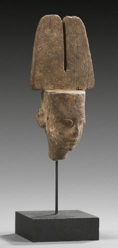 Wooden head of Amun with double feather-crown. Late Period, 664 - 332 B.C.