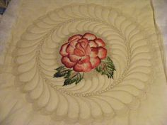 """The Rose Materials  muslin, fabric paints, a light light polyester batting over cotton batting   I painted the rose just so I could do the feathers so that they look like they are behind the rose. It is about 18"""" in diameter and will be cut into circular quilt when bound. I was demonstrating painting at a quilt exhibit by my group today. I couldn't wait to get home to quilt it.  What are you most proud of?  I am learning. My quilting has changed since I took Cindy's class. For…"""