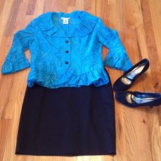 Stunning Blue Top Ruffles around the neckline, hem and sleeves. Floral design the top is lined and the sleeves are sheer. Black accent buttons Jackie Jon New York Tops