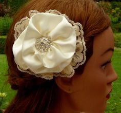 This elegant hair bloom in white is a beautiful bridal hair accessories. The flower is fully and elaborately handcrafted from satin farbric and lace in a soft creamy colour... #etsy #jewelry #hairjewelry #necklace #earrings #craftoriteam