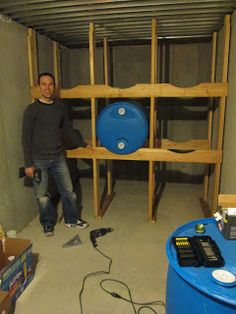 Water Barrel storage & Water Storage Rack. What a great idea! I think this would be a great ...