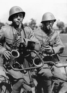 WWII Dutch Army saxophonists on bicycles. Note special handlebars -- must have…