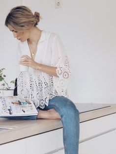 White flowy overlay v-neck lace shirt and light-wash jeans + low bun. Comfy, casual, school fashion, summer fashion, fall clothing, womens and girls fashion