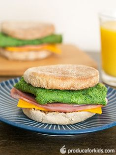 Green Eggs and Ham Breakfast Sandwich - Get kids to eat their veggies with this fun and tasty green eggs and ham recipe! This healthy breakfast sandwich is ready in under 10 minutes and perfect for celebrating Dr. Suess' birthday and St. Patrick's Day. #SoyFree #NutFree @produceforkids