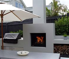 modern outdoor fireplace incorporated into an outdoor kitchen area Contemporary Outdoor Fireplaces, Outdoor Kitchen Design, Modern Outdoor, Fireplace Design, Rustic Outdoor, Rustic Outdoor Fireplaces, Contemporary Outdoor, Modern Outdoor Fireplace, Outdoor Kitchen