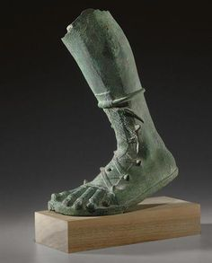 A ROMAN BRONZE LEFT LEG CIRCA 2ND-3RD CENTURY A.D. #romanpottery Roman Sculpture, Sculpture Clay, Roman Armor, Roman Clothes, Ancient Artefacts, Hermes, Roman Sandals, Ancient Rome, Ancient History