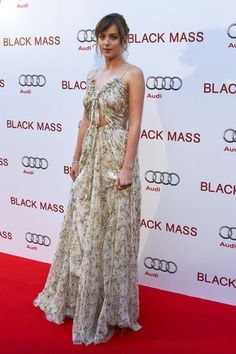 Dakota Johnson looks stunning in her Alexander McQueen gown at the 'Black Mass' premiere. http://thestir.cafemom.com/beauty_style/190818/dakota_johnsons_flawless_toronto_film