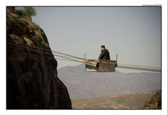 A Greek monk travels to his monastery via aerial tramway