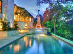 Pool, spa, rear terrace, and outdoor fireplace