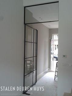 Stalen taatsdeur met bovenlicht, Project A'dam Bennebroek