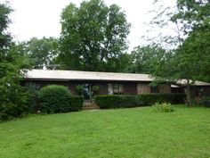 Tucked in the trees just out of town, this beautiful home offers two bedrooms with potential for another to be added! The home is spacious and warm, offering an open floor plan! There is a south side sun room and an east side deck over-looking the garden and mature trees in the yard! Enjoy your first cup of coffee in the peace and quiet of these quiet spaces! Fruit trees, garden area, storm shelter, chicken coop, circle drive, blacktop frontage and so much more!! in Cabool MO