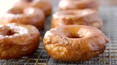 pumpkin donuts made with Grands! Bake biscuits into doughnuts and add a quick pumpkin glaze for a fall flavor upgrade. Churros, Pumpkin Recipes, Fall Recipes, Sweet Recipes, Southern Recipes, Coffee Recipes, Empanadas, Pillsbury Recipes, Pillsbury Rolls