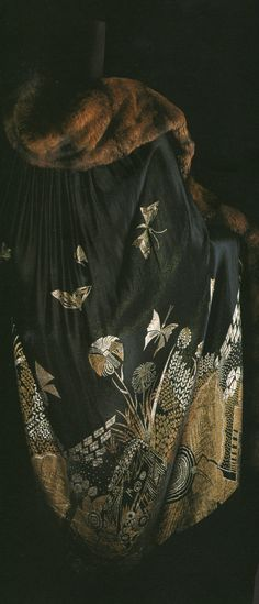 "japonismefashion: "" Cape 1925 Black lame jacquard patterned with a natural motif; fur trimming; no lining. Japanese lacquer was one of the media used to express Art Deco style in the 1920s. Surface..."