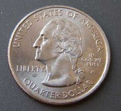 """Minting errors on some 2005 Kansas coins make the customary message """"In God We Trust"""" appear to read """"In God We Rust."""""""