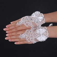 Remedios Boutique Ivory Lace Fingerless Wrist Length Bridal Gloves with Rhinestone Bow Remedios Boutique http://www.amazon.co.uk/dp/B00NBM5EG4/ref=cm_sw_r_pi_dp_K3ddub1E219GR