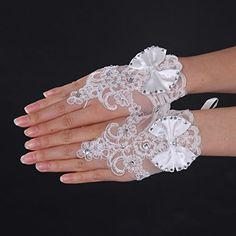 Remedios Boutique Ivory Lace Fingerless Wrist Length Bridal Gloves with Rhinestone Bow Remedios Boutique http://www.amazon.co.uk/dp/B00NBM5EG4/ref=cm_sw_r_pi_dp_K3ddub1E219GR
