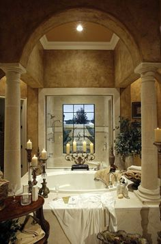Old World bathroom -- Love the wall treatments, iron candelabras, plants, lush linens. | Elegant Homes