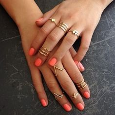little golden rings + coral nails. I usually don't like rings at the tips of fingers but this is cute