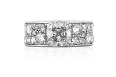 """""""pebble"""" diamond rose cut band with cushion cut diamond center and set in platinum"""