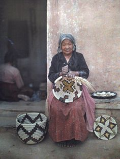 Arizona - Portrait of a Hopi Indian holding one of the baskets she's made