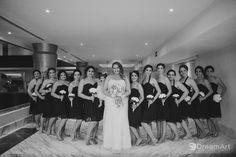 Bride and bridesmaids captured on a Wedding Photography session at #MoonPalace @prweddings @palaceresorts #DreamArtPhotography #DreamArtWeddings #WeddingPhotography #Wedding #DestinationWeddings #Photography #Cancun #CancunPhotography #Mexico #Bride #Bridesmaids #WeddingGown #Light #BWPhotography #BlackAndWhite