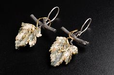 http://www.barbarachristie.com/ oxidized silver branch with 18ct yellow gold detail, picasso jasper  leaf earrings by Barbara Christie