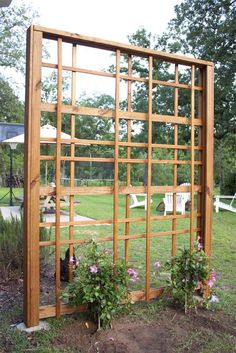 Build a DIY garden trellis that& as beautiful covered in flowers as it is without. It& an intriguing design that might look complicated but is so easy to replicate. Here& how to make your own DIY garden trellis. Bamboo Trellis, Wooden Trellis, Diy Trellis, Trellis Ideas, Garden Arch Trellis, Flower Trellis, Grape Trellis, Wall Trellis, Trellis Design