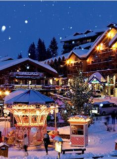 Courchevel 1850 in the 3 Valleys, France at Christmas time. The merry go round you can see is always a big hit with the children we look after at SnowBugs Nannies Beautiful World, Beautiful Places, Amazing Places, Christmas In Europe, Christmas Markets, German Christmas, Christmas Villages, Christmas Time, France 3