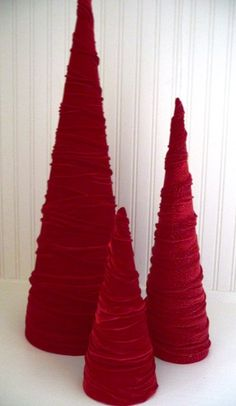 cone trees diy....I love these. The velvet ribbon is so sweet. I could see topping them with vintage broaches.