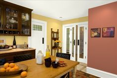Welcoming Spicy Kitchen! Wall Color: Marlbehead Gold - Trim & Ceiling Color: White Dove - Accent Wall Color: Audubon Russet