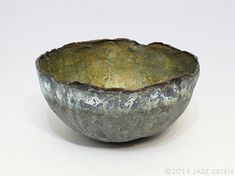 Paper bowl with distressed finish