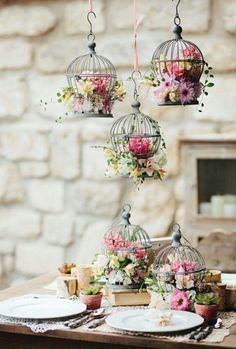 Great idea using bird cage for flower arrangement.