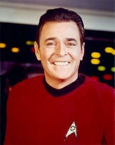 Scotty flashing a big grin during season three of the original series.